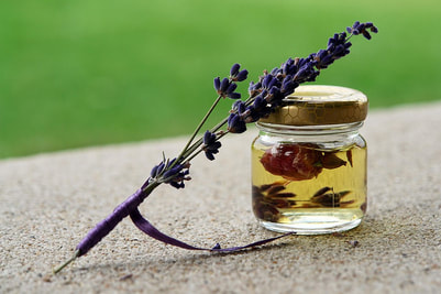 Picture flower leaning on a herbal in a jar of oil